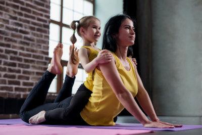 girl and a woman doing yoga